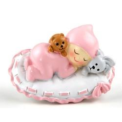 Imán bebé sobre almohada en rosa