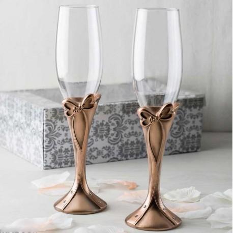 Juego de dos copas, decoradas con lazo de bronce
