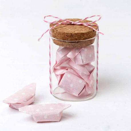 Tarrito con 5 caramelos con papel rosa y decorados con topos