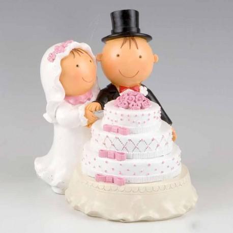 Figura con los novios cortando la tarta de la boda