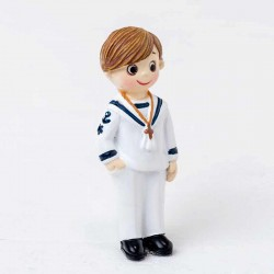 Imán niño marinero mano en el bolsillo