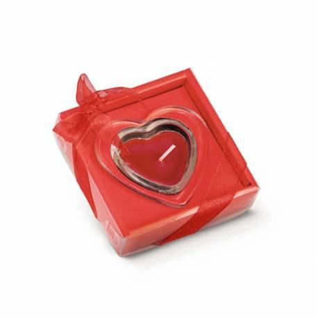 Vela con base de cristal con forma de corazón.