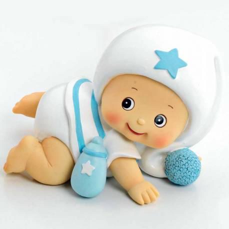 Figura bebé con pijama blanco, tambien es una hucha. Para la tarta de bautizo