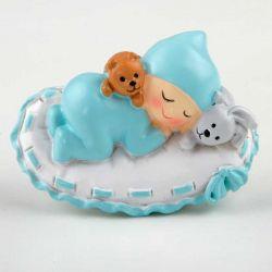 Imán bebé sobre almohada en azul