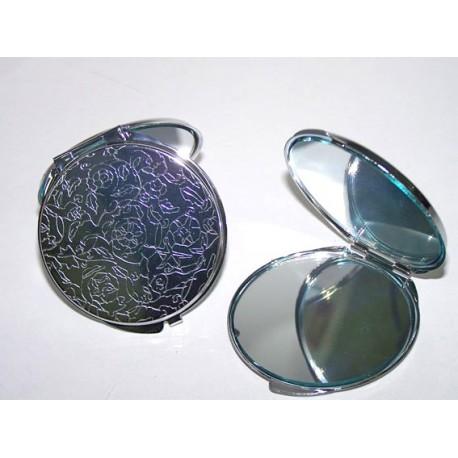 Espejo de metal doble labrado, motivo floral