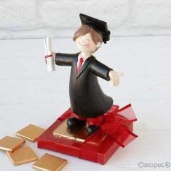 Figura de graduación chico y 8 napolitanas