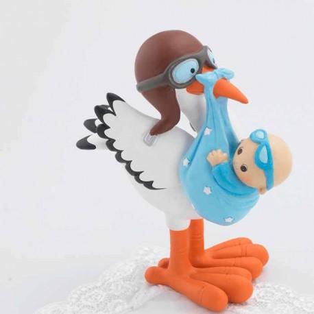 Cigueña con bebé gafitas celeste, la cigüeña lleva un casco y unas gafas de aviador