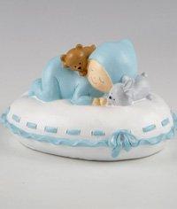 Figura tarta bautizo hucha Pit sobre almohada